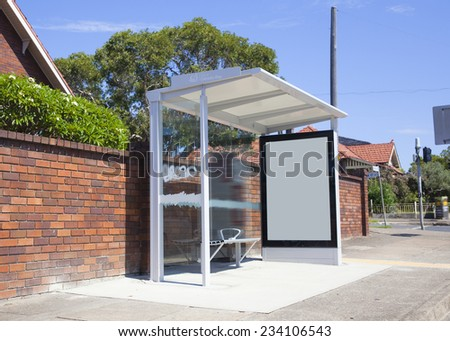 Sydney City street bus station, attached advertising light boxes - stock photo