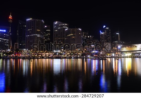 Sydney Darling Harbour at night with the marina, restaurants and skyscrapers.  - stock photo