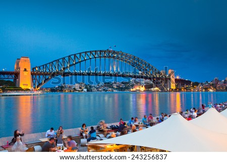 SYDNEY - DEC 26: Night view of Sydney Harbour Bridge in Sydney, Australia on December 26,2011. The Harbour Bridge is the world's widest long-span bridge.  - stock photo