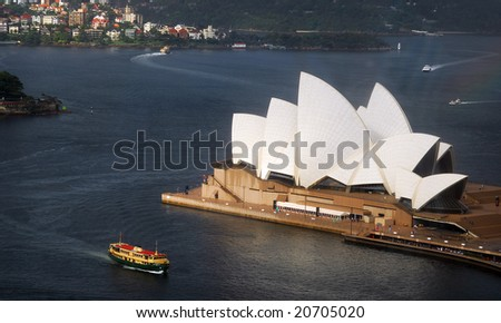 SYDNEY, February 10, 2008 - Late afternoon summer shot featuring elevated side view of Sydney Opera House with harbour ferry in foreground.  Photographed in Sydney, Australia on 10 February, 2008 - stock photo