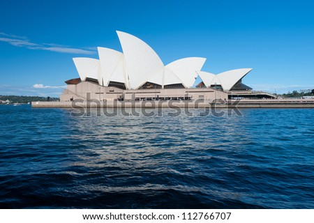 SYDNEY - FEBRUARY 10: The Iconic Sydney Opera House is a multi-venue performing arts centre also containing bars and outdoor restaurants. February 10, 2012 in Sydney, Australia. - stock photo