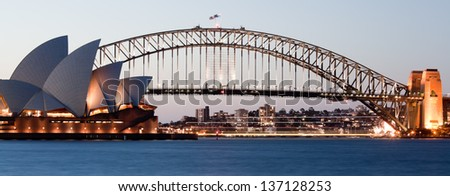 SYDNEY - FEBRUARY 6: The Sydney Opera House with Harbor bridge in Sydney, Australia on February 6, 2013. Designed by Danish architect Jorn Utzon; this year is celebrating the 40th opening anniversary - stock photo