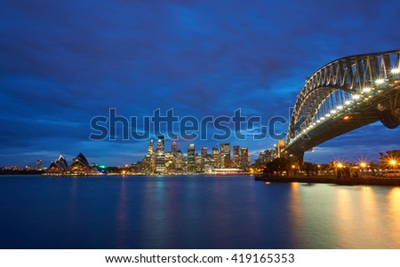 Sydney Harbour Bridge and Opera House view from Luna Park - stock photo