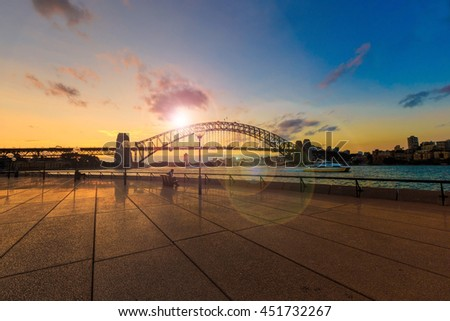 Sydney Harbour Bridge at sunset with sun glare and lens flare(intention) - stock photo