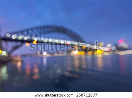 sydney harbour bridge in early morning taken as blury bokeh background - stock photo
