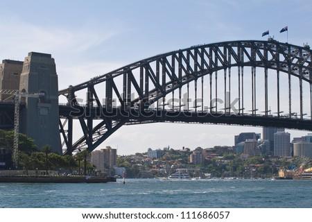 Sydney Harbour bridge, with tourists hiking the famous bridgewalk. - stock photo