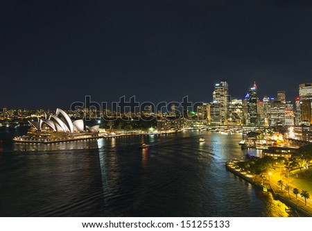 sydney harbour skyline at night in australia - stock photo