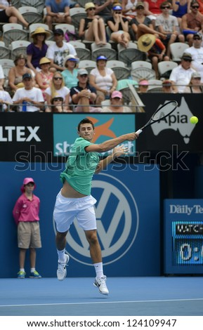SYDNEY - JAN 9: Bernard Tomic from Australia pounds for a forehand in his second round match in the APIA Sydney Tennis International. Sydney January 9, 2013. - stock photo