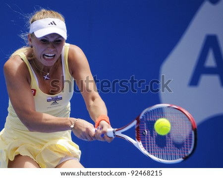 SYDNEY - JAN 10: Caroline Wozniacki hits a backhand in her opening round match in the APIA Tennis International. Sydney - January 10, 2012 - stock photo