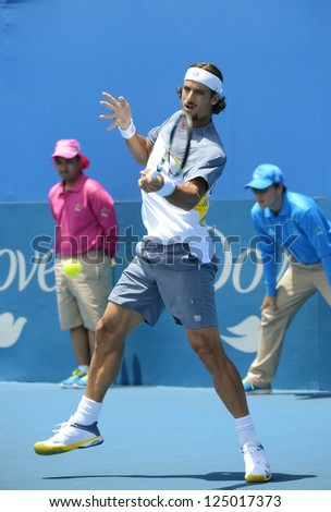 SYDNEY - JAN 9: Feliciano Lopez from Spain hits a forehand at the APIA Sydney Tennis International. Sydney January 9, 2013. - stock photo