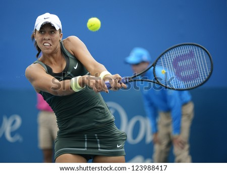 SYDNEY - JAN 7: Madison Keys from USA hits a backhand during her first round match in the APIA Sydney Tennis International. Sydney January 7, 2013. - stock photo