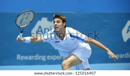 SYDNEY - JAN 9: Marcel Granollers from Spain reaches for a forehand at the APIA Sydney Tennis International. Sydney January 9, 2013. - stock photo