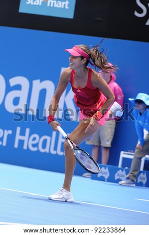 SYDNEY - JAN 8: Serbian Ana Ivanovic serves during her first round match in the APIA Tennis International. Sydney - January 8, 2012 - stock photo
