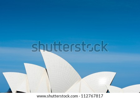 SYDNEY - JANUARY 8: The Iconic Sails of the Sydney Opera House are made up of over one million white, self cleaning tiles. January 8, 2012 in Sydney, Australia. - stock photo