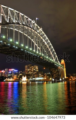 Sydney lights reflected in Sydney Harbor under the Sydney Harbor Bridge - stock photo