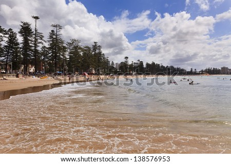 sydney manly beach zone day time ocean wave in bay people relaxing and surfing in the residential town - stock photo