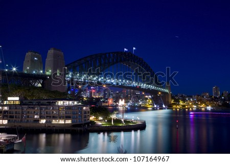 SYDNEY - MARCH 26:Night view of Sydney Harbour Bridge in Sydney, Australia on March 26,2012. The Harbour Bridge is the world's widest long-span bridge. - stock photo