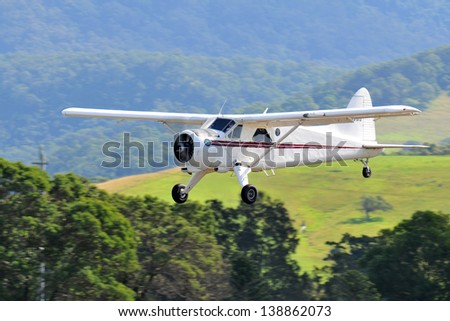 SYDNEY - MAY 5: A Beaver aircraft flies by during the Wings Over Illawarra Airshow on May, 2013 near Sydney. - stock photo
