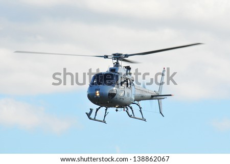 SYDNEY - MAY 5: A Squirrel military helicopter hovers in the air during the Wings Over Illawarra Airshow on May, 2013 near Sydney. - stock photo