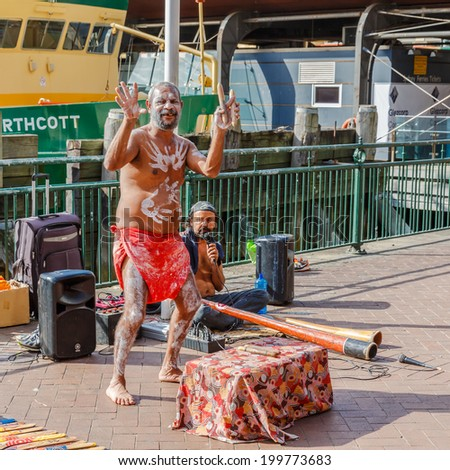 SYDNEY - MAY 10: Aborigin duo performed their music at Sydney harbour on May 10, 14 in Sydney. Aborigin is the local population of Australia prior the immigration of the British. - stock photo