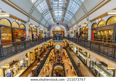 SYDNEY - MAY 15: People shop at Queen Victoria Building (QVB) on May 15, 2014 in Sydney. It is a late nineteenth-century building designed by the architect George McRae in Sydney, Australia. - stock photo