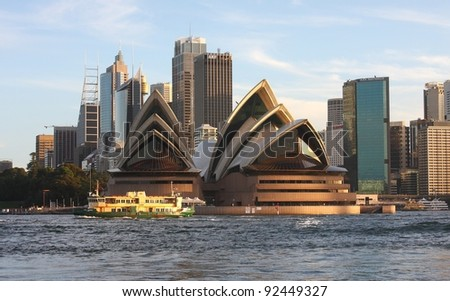 SYDNEY - MAY 4: Sydney Opera House and CBD view on May 4, 2011 in Sydney. Opera House is one of the most distinctive buildings and one of the most famous performing arts centres in the world. - stock photo