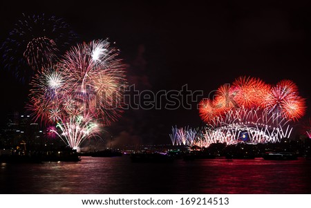 Sydney 2014 new year firework display. Multiple explosions over the Sydney in front of the Harbour Bridge and Opera House - stock photo