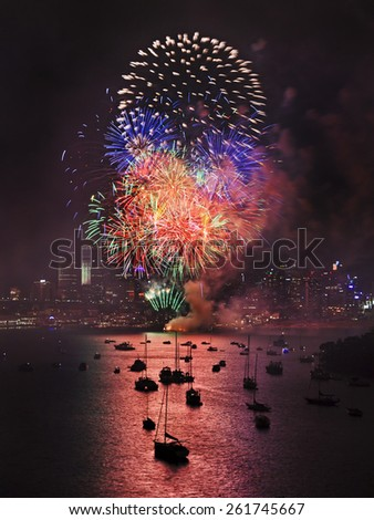 Sydney New Year fireworks above city city-line with bright colorful fire balls explode in dark sky - stock photo
