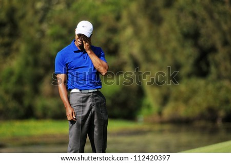 SYDNEY - NOV 12: American Tiger Woods anguish at his shot in the third round in the Australian Open at The Lakes golf course. Sydney - stock photo