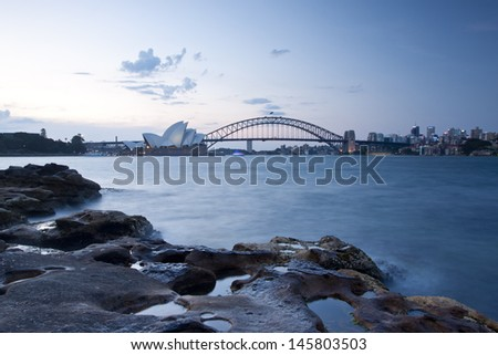 SYDNEY - NOV 26:Night view of Sydney Harbour Bridge and Opera House in Sydney, Australia on November 26,2011. The Harbour Bridge is the world's widest long-span bridge. Opera House is the landmark. - stock photo