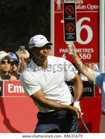 SYDNEY - NOV 11: Tiger Woods plays a tee shot in the second round in the Australian Open at The Lakes golf course. Sydney, November 11, 2011 - stock photo