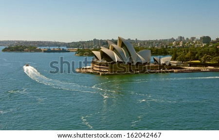 SYDNEY - NOVEMBER 6: Sydney Opera House view on November 6, 2013 in Sydney, Australia. The Sydney Opera House is a famous arts center. It was designed by Danish architect Jorn Utzon.  - stock photo