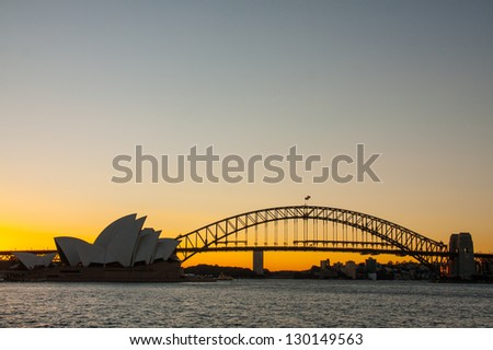 SYDNEY, NSW/AUSTRALIA-AUGUST 31 : Sunset at Opera house on August 31, 2009. This building is the landmark of Sydney city and Australia located in Sydney harbour. - stock photo