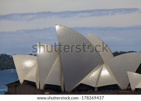 "SYDNEY, NSW, AUSTRALIA - DECEMBER 29: A view of the famous Sydney Opera House on December 29, 2009. The building's design features a series of large precast concrete ""shells"" said to look like sails.  - stock photo"