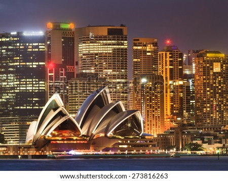 Sydney, NSW, Australia - February 15, 2015: Australian Sydney's landmarks - city CBD houses at sunset brightly illuminated shot across Sydney Harbour  - stock photo