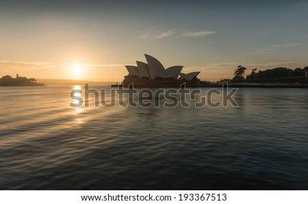 SYDNEY, NSW/AUSTRALIA-July 28 : Sunrise at Opera house landmark of Sydney city and Australia locate in Sydney harbor on July 28, 2013. - stock photo