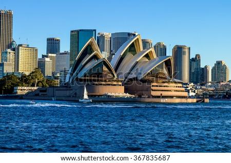 SYDNEY, NSW / AUSTRALIA - JULY 5, 2014: View from ferry, City CBD and Opera House  on July 5, 2014. in Sydney, Australia. - stock photo