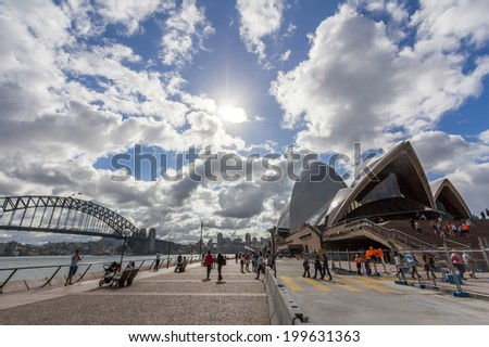 SYDNEY, NSW, AUSTRALIA - May 30, 2014: Sydney opera house and harbor bridge. The opera house provides a venue for the performing arts in Australia's largest city, Sydney.  - stock photo
