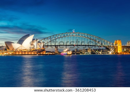 SYDNEY - OCTOBER 16, 2015: Night view of Sydney Harbour. More tha 15 million people visit Sydney annually. - stock photo