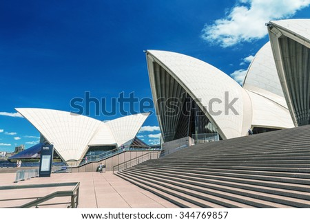 SYDNEY - OCTOBER 12, 2015: The Iconic Sydney Opera House is a multi-venue performing arts centre also containing bars and outdoor restaurants - stock photo