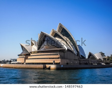 SYDNEY-SEPTEMBER 22 : Sydney opera house with blue sky in  Sydney,Australia on 22 September 2012 .It was designed by Danish architect Jorn Utzon. - stock photo