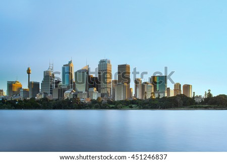 Sydney skyline sunset view from Royal Botanic garden - stock photo