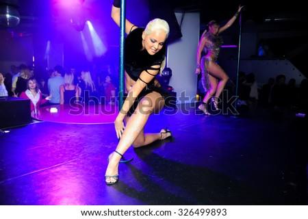 "SYKTYVKAR, RUSSIA - DECEMBER 06, 2008: pole dancer in ""9000 metrov"" night club. ""9000 metrov"" was one of the biggest night club in Syktyvkar - stock photo"