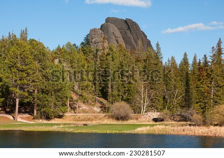 Sylvan Lake in the Black Hills of South Dakota. Utility wires removed from scene. - stock photo