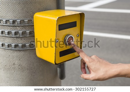 Symbol for disabled person at the traffic light - stock photo