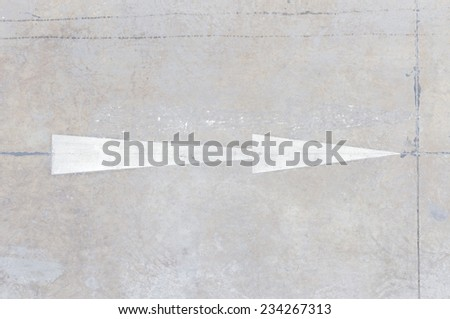 Symbol navigation arrows on the road - stock photo