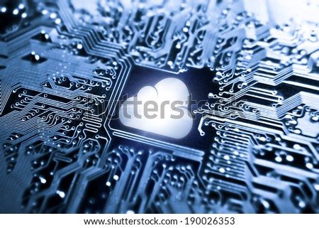 symbol of a cloud on computer circuit board - cloud computing - stock photo