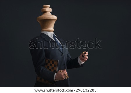 Symbol of a Headless Narcissist with pawns in the hands - stock photo