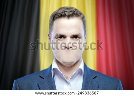 Symbol of censorship and freedom of speech: a young man without a mouth on a background of the national flag of Belgium - stock photo