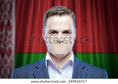 Symbol of censorship and freedom of speech: a young man without a mouth on a background of the national flag of Belarus - stock photo